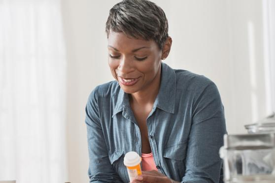 woman looking at her medication