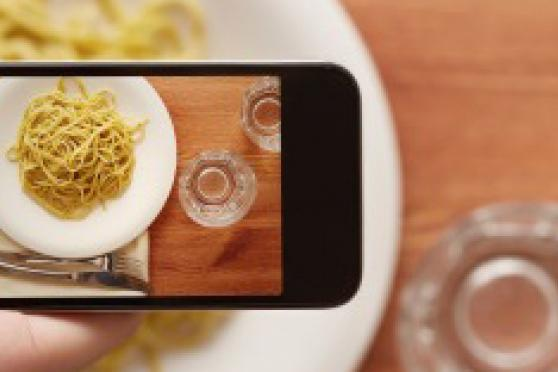 Photo: Snapping picture of meal with smart phone
