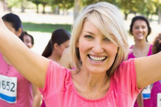 Photo: Happy women in pink t-shirts at running race