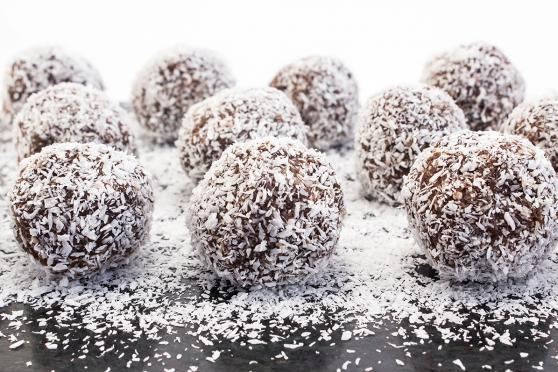 Chocolate balls covered with coconut flakes