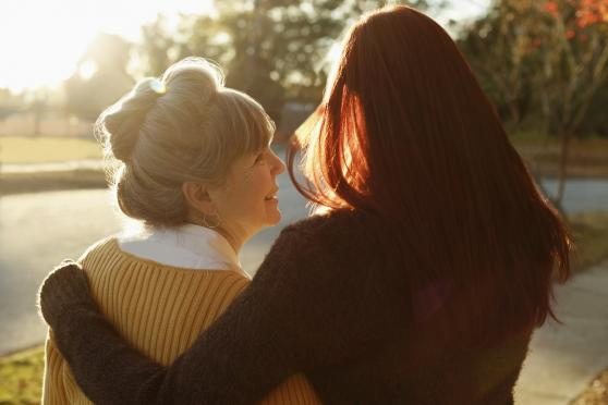Photo: 2 women hugging